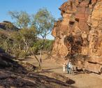 Stock Photo of tourists at chambers gorge aboriginal engraving site. flinders ranges. south