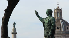 Caesar statue &  Trajan's Column in Rome 1 Stock Footage