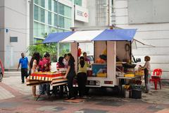 mobile vendor sell fast food on a street - stock photo