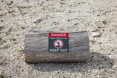 warning sign telling of geothermal danger - stock photo