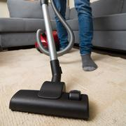 Cleaning home with vacuum cleaner Stock Photos