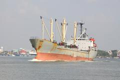 Ship for contain product in wide river. Stock Photos