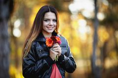 Girl with a flower - stock photo
