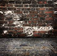 Grunge background, red brick wall texture bright plaster wall and blocks road Stock Photos