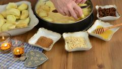 Apple pie baking. Spreading apple slices on the pie dough. Stock Footage