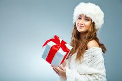 Young attractive girl in Christmas style over grey Stock Photos