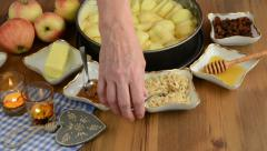 Apple pie baking. Lays spoons into the bowl Stock Footage