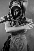 strong dance, beautiful brunette woman in armor formed by mirrors - stock photo
