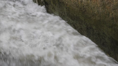 Overflowing river of water rushing Stock Footage