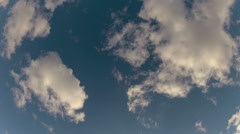 Clouds under the blue sky. 1 minute time-lapse shot - stock footage