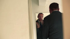 Businessman motivating himself in front of the mirror HD Stock Footage