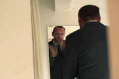 Businessman motivating himself in front of the mirror NTSC Stock Footage