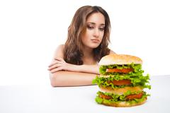 Stock Photo of Healthy woman rejecting junk food isolated