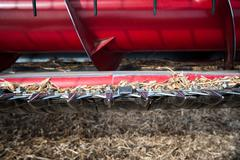 Red Combine, cutting blades close up - stock photo