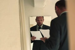 Businessman training his speech in front of the mirror NTSC Stock Footage