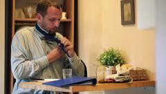Young businessman tying necktie in kitchen HD Stock Footage