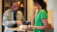Businessman going out to work, gets lunch from his wife HD Stock Footage