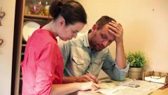 Sad couple reading newspaper ads in home HD Stock Footage