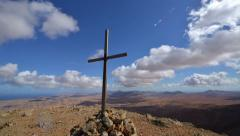 Cross and time lapse clouds on top of the mountain 11129 Stock Footage