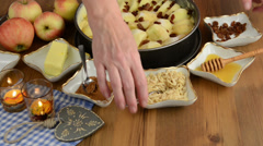 Apple pie baking. Sprinkled slivered almonds on the raw apple pie. Stock Footage