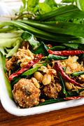 Thai dish : fried spicy minced pork with herb Stock Photos