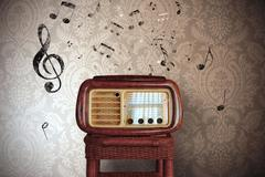 vintage music notes with old radio - stock photo