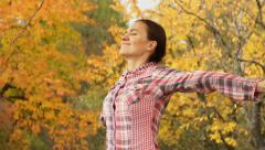 Young woman breathing in autumn park HD - stock footage