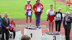 Winners and their trainers on podium at XXI Moscow supermarathon Stock Footage