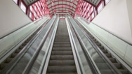 Stock Video Footage of Two lines of escalator move up and down, one is in reserve