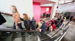 Children from orphanage ride on escalator near entrance Stock Footage