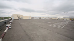 Cars on roof parking and industrial zone near shopping center Stock Footage
