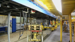 Hoses and cylinder for chassis system of train wagon at workshop Stock Footage