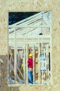 wood frame construction job seen trhough window opening - stock photo