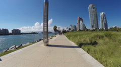 People walking at South Pointe Park Stock Footage