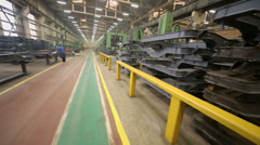 Chassis spare parts and people work at factory Stock Footage