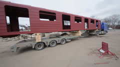 Long vehicle for train wagons transportation near factory Stock Footage
