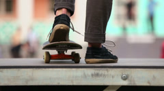 Legs of skateboarder which star ride on board from ramp Stock Footage