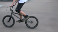 Stock Video Footage of Boy rides on bike by ramps at opening of skatepark