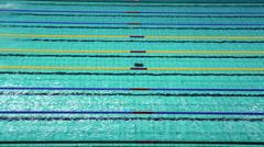 Sportswomen swim butterfly stroke during Championship Stock Footage