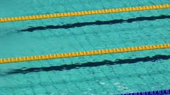 Sportsmen swim backstroke in pool at Championship of Russia Stock Footage