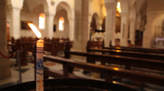 Lighted candle in church Stock Footage
