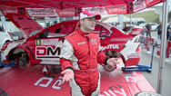 Stock Video Footage of Sportsman Novikov speaks near car of team ALM RUSSIA