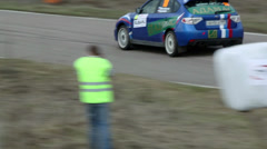 Blue race car rides by road during Rally Masters Show Stock Footage
