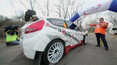 V.Gryazin and S.Gryazin start ride in racing car Stock Footage