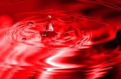 Red multi colored water drop bubbling Stock Photos