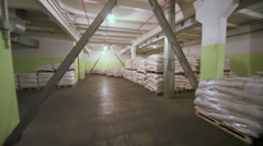 Sacks with corn grits for beer in warehouse of brewery factory Stock Footage