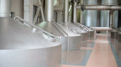 Large cisterns with tubes in workshop of brewery factory Stock Footage