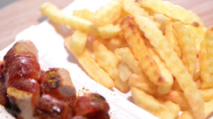 Rotating german currywurst Stock Footage
