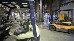 Woman turns on machine for packaging beer bottles at depot - stock footage