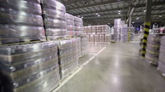 Many stacks with packaged beer in warehouse of brewery factory Stock Footage